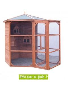 Voliere bois hexagonale PO H23 grande taille avec sas. Cette cage à oiseaux est en bois non traité