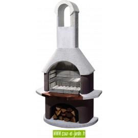 Barbecue à bois St Moritz. Ce barbecue a charbon de bois ou au bois en béton, est un barbecue cheminée de la marque Buschbeck